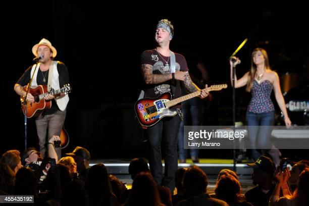 Tom Gossin Mike Gossin and Rachel Reinert of Gloriana perform at Cruzan Amphitheatre on September 13 2014 in West Palm Beach Florida
