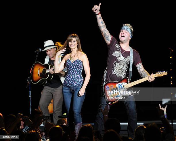 Tom Gossin Rachel Reinert and Mike Gossin of Gloriana perform at Cruzan Amphitheatre on September 13 2014 in West Palm Beach Florida