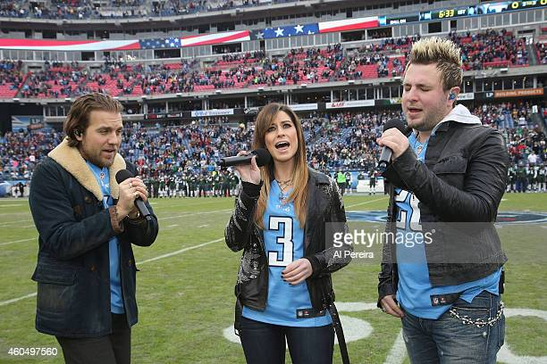 Tom Gossin Rachel Reinert and Mike Gossin of Gloriana perform the National Anthem before the New York Jets Vs Tennessee Titans game at LP Field on...