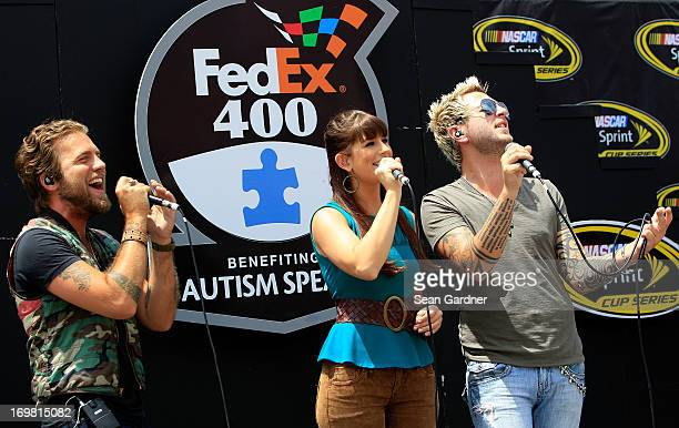 Tom Gossin Rachel Reinert and Mike Gossin of the band Gloriana perform during prerace ceremonies for the NASCAR Sprint Cup Series FedEx 400...