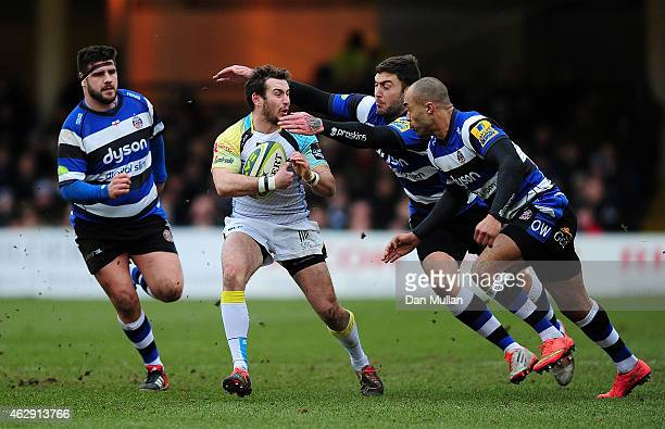 Tom Grabham of Ospreys is tackled by Olly Woodburn and Matt Banahan of Bath during the LV= Cup match between Bath Rugby and Ospreys at Recreation...