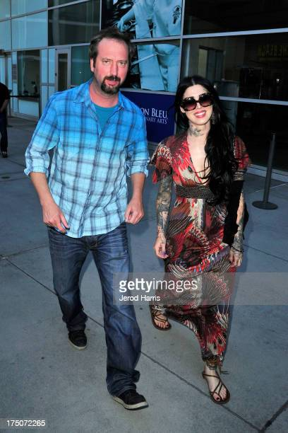 Tom Green and Kat Von D arrive at the premiere of 'The Motivation' at ArcLight Hollywood on July 30 2013 in Hollywood California