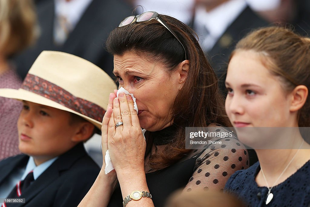 Tom Greig, Vivian Greig and Beau Greig watch footage of their late father and husband during the Tony Greig memorial service at Sydney Cricket Ground on January 20, 2013 in Sydney, Australia.
