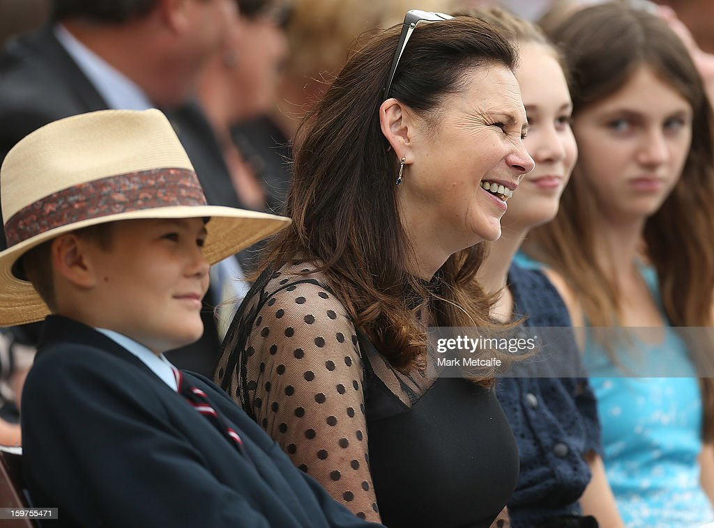 Tom Grieg, Vivian Grieg and Beau Greig smile during the Tony Greig memorial service at Sydney Cricket Ground on January 20, 2013 in Sydney, Australia.