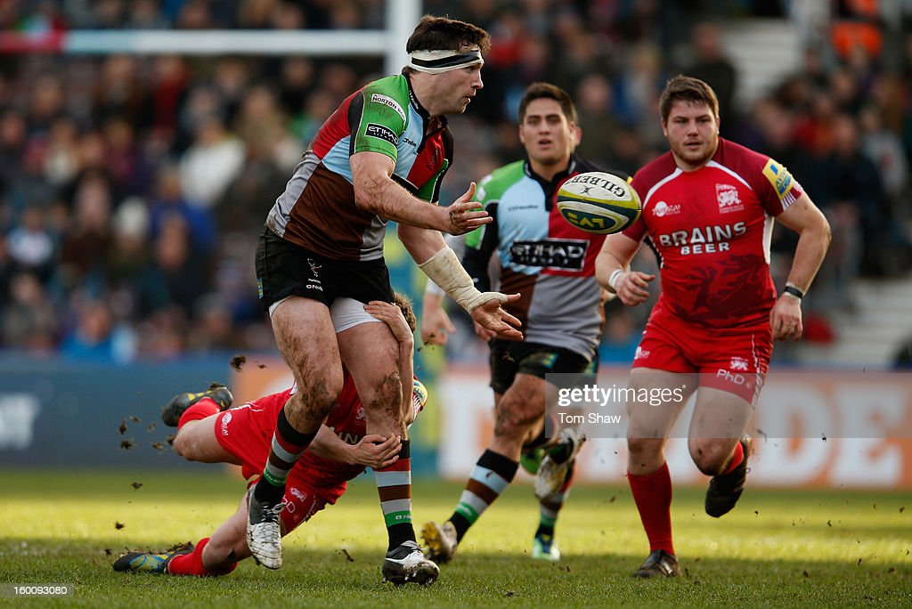 Tom Guest of Quins is tackled during the LV= Cup match between Harlequins and London Welsh at Twickenham Stoop on January 26, 2013 in London, England.