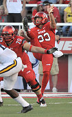 Tom Hackett of the Utah Utes watches his kick during their game against the Michigan Wolverines at RiceEccles Stadium on September 3 2015 in Salt...