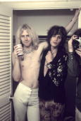 Tom Hamilton and Steven Tyler of Aerosmith posing backstage in 1973 in Newport Rhode Island