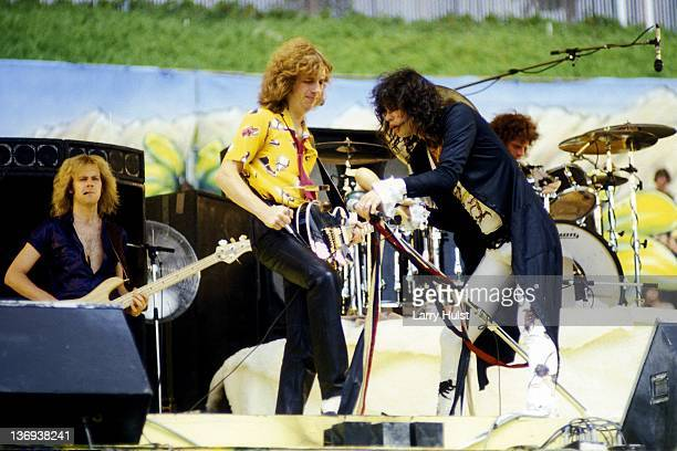 Tom Hamilton Brad Whitford and Steve Tyler performing with 'Aerosmith' at the Oakland Coliseum in Oakland California on August 21 1979