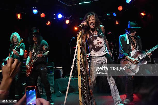 Tom Hamilton Slash Steven Tyler and Joe Perry perform onstage during Aerosmith's summer 'Let Rock Rule' tour launch at Whisky a Go Go on April 8 2014...