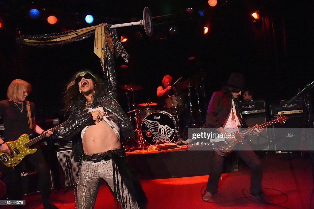 Tom Hamilton Steven Tyler Joey Kramer and Joe Perry perform onstage during Aerosmith's summer 'Let Rock Rule' tour launch at Whisky a Go Go on April...