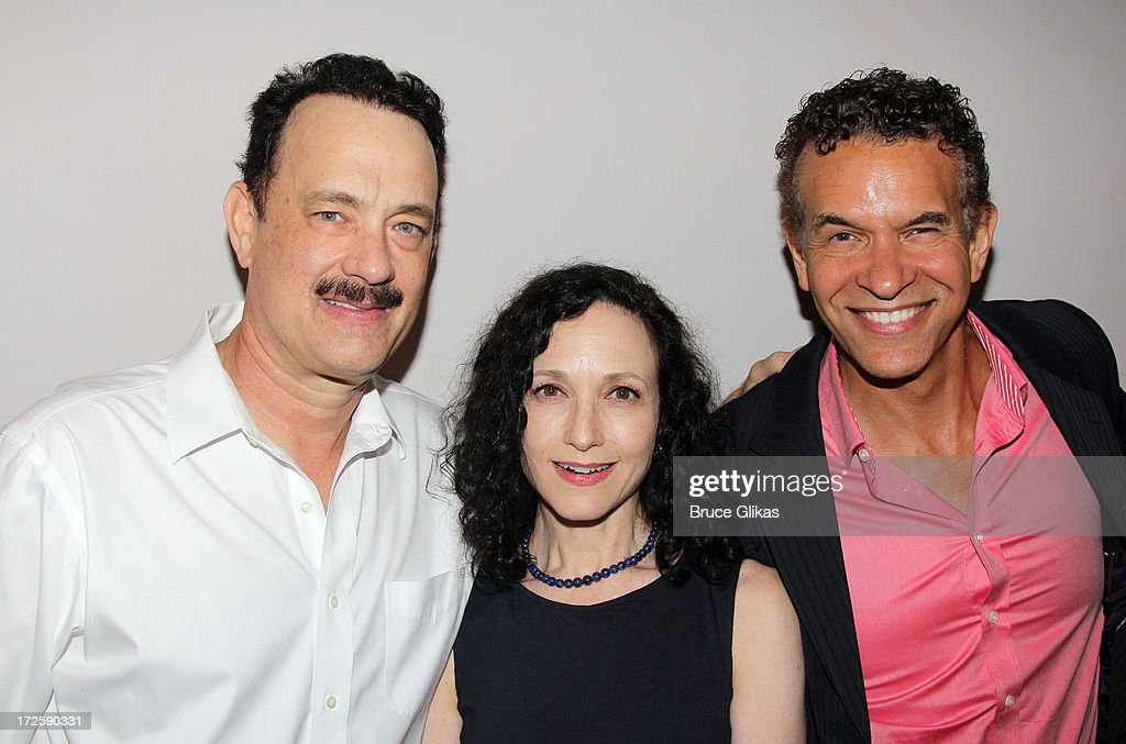<a gi-track='captionPersonalityLinkClicked' href=/galleries/search?phrase=Tom+Hanks&family=editorial&specificpeople=201790 ng-click='$event.stopPropagation()'>Tom Hanks</a>, Actors Fund President's <a gi-track='captionPersonalityLinkClicked' href=/galleries/search?phrase=Bebe+Neuwirth&family=editorial&specificpeople=210769 ng-click='$event.stopPropagation()'>Bebe Neuwirth</a> and <a gi-track='captionPersonalityLinkClicked' href=/galleries/search?phrase=Brian+Stokes+Mitchell&family=editorial&specificpeople=213301 ng-click='$event.stopPropagation()'>Brian Stokes Mitchell</a> pose backstage at The Actors Fund of America's benefit final matinee performance of Broadway's 'Lucky Guy' at The Broadhurst Theatre on July 3, 2013 in New York City.