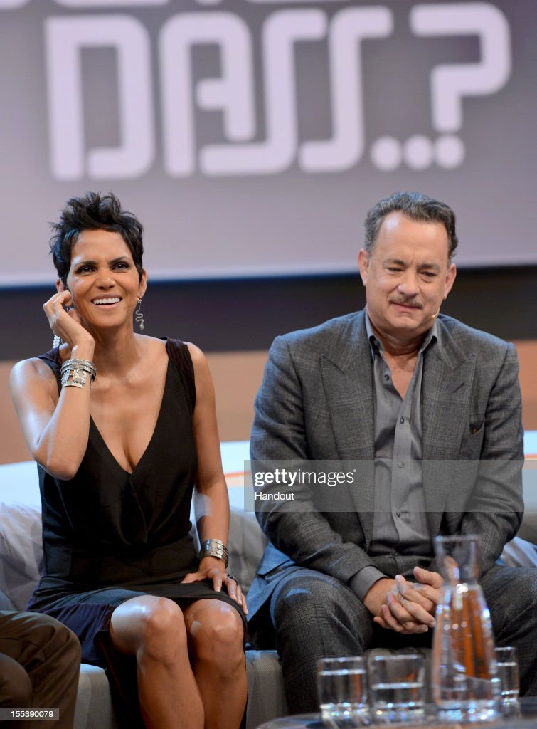 Tom Hanks and Halle Berry react during the 'Wetten dass' show on November 3 2012 in Bremen Germany
