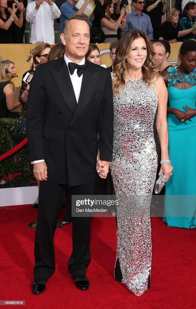 Tom Hanks and Rita Wilson (R) arrive at the 20th Annual Screen Actors Guild Awards at the Shrine Auditorium on January 18, 2014 in Los Angeles, California.