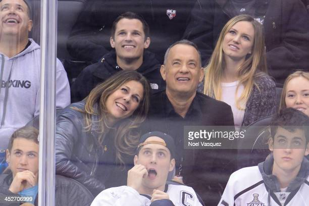 Tom Hanks and Rita Wilson attend a hockey game between the Calgary Flames and the Los Angeles Kings at Staples Center on November 30 2013 in Los...
