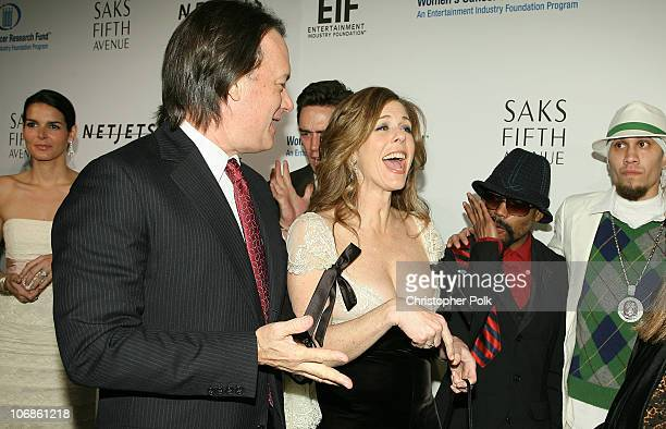 Tom Hanks and Rita Wilson during Saks Fifth Avenue's Unforgettable Evening Benefiting Women's Cancer Research Fund Arrivals and Inside at The Regent...