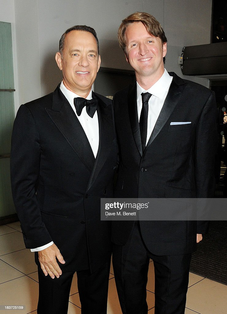 Tom Hanks (L) and Tom Hooper attend the European Premiere of 'Captain Phillips' on the opening night of the 57th BFI London Film Festival at Odeon Leicester Square on October 9, 2013 in London, England.