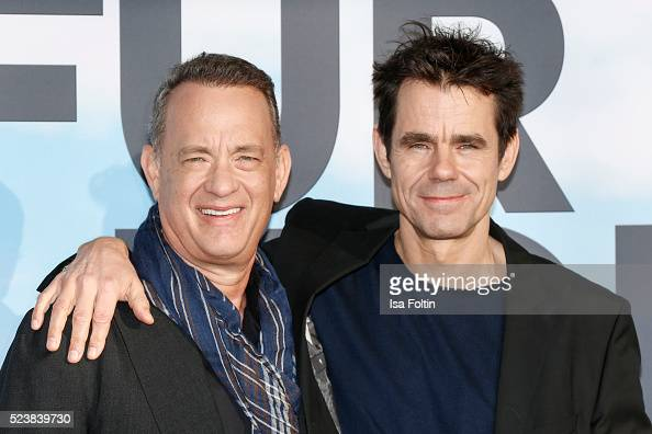 Tom Hanks and Tom Tykwer attend the German premiere for the film 'A Hologram for the King' at Zoopalast on April 24 2016 in Berlin Germany
