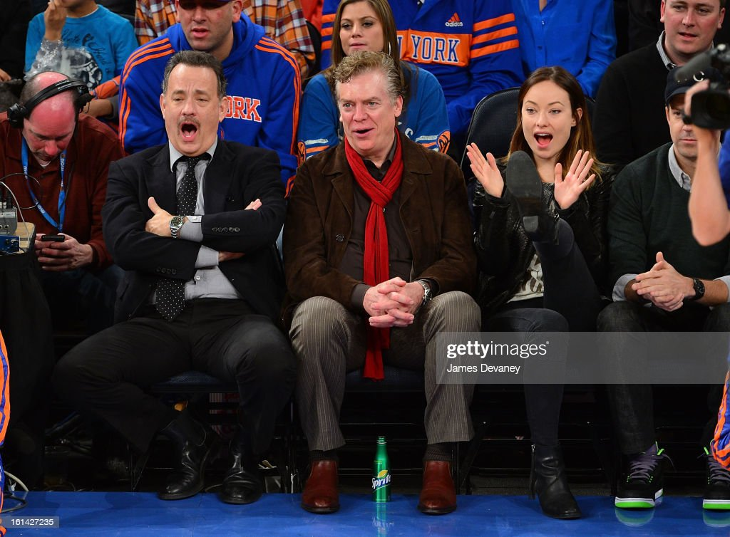 Tom Hanks Christopher McDonald and Olivia Wilde attend the Los Angeles Clippers vs New York Knicks game at Madison Square Garden on February 10 2013...
