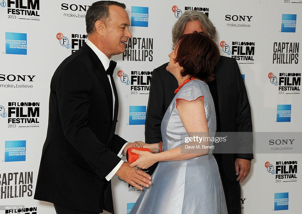 Tom Hanks, Clare Stewart and Paul Greengrass attend the European Premiere of 'Captain Phillips' on the opening night of the 57th BFI London Film Festival at Odeon Leicester Square on October 9, 2013 in London, England.