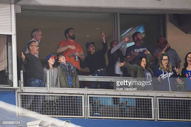 Tom Hanks Gary Goetzman Nia Vardalos Suzy Nakamura and guests attend a baseball game between the New York Mets and the Los Angeles Dodgers at Dodger...