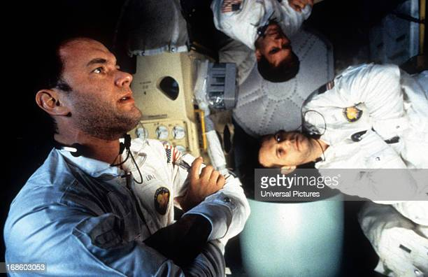 Tom Hanks Kevin Bacon and Bill Paxton in zero gravity in a scene from the film 'Apollo 13' 1995