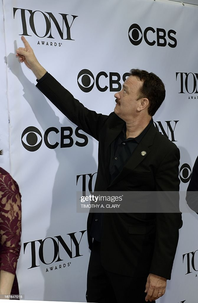Tom Hanks nominated for Best performance by an actor in a leading role in 'Lucky Guy' attends a photo session on May 1, 2013. The play is also nominated for Best Play in the 67th Tony Awards.