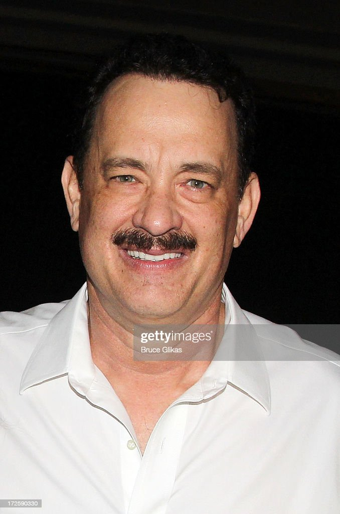 Tom Hanks poses backstage at The Actors Fund of America's benefit final matinee performance of Broadway's 'Lucky Guy' at The Broadhurst Theatre on July 3, 2013 in New York City.