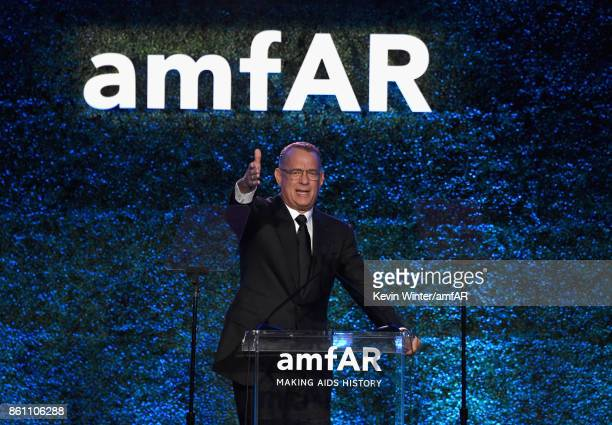 Tom Hanks speaks onstage at the amfAR Gala Los Angeles 2017 at Ron Burkle's Green Acres Estate on October 13 2017 in Beverly Hills California
