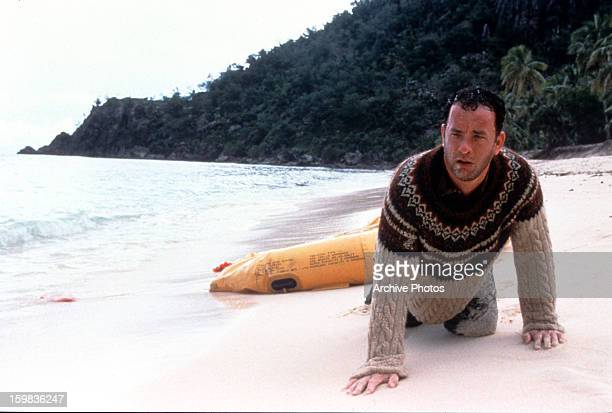 Tom Hanks washed up on the beach of an island in a scene from the film 'Cast Away' 2000