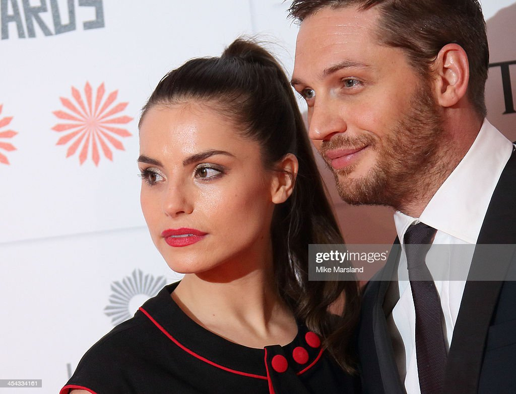 <a gi-track='captionPersonalityLinkClicked' href=/galleries/search?phrase=Tom+Hardy+-+Actor&family=editorial&specificpeople=2209780 ng-click='$event.stopPropagation()'>Tom Hardy</a> and <a gi-track='captionPersonalityLinkClicked' href=/galleries/search?phrase=Charlotte+Riley&family=editorial&specificpeople=5583674 ng-click='$event.stopPropagation()'>Charlotte Riley</a> attend the Moet British Independent Film Awards at Old Billingsgate Market on December 8, 2013 in London, England.