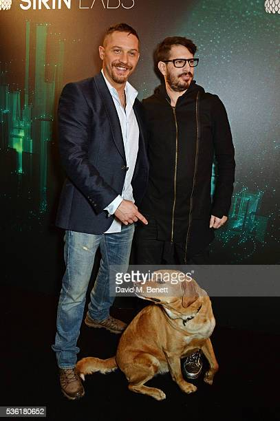 Tom Hardy and Moshe Hogeg pose with Tom's dog Woody attend as SIRIN LABS Launches SOLARIN at One Marylebone on May 31 2016 in London England