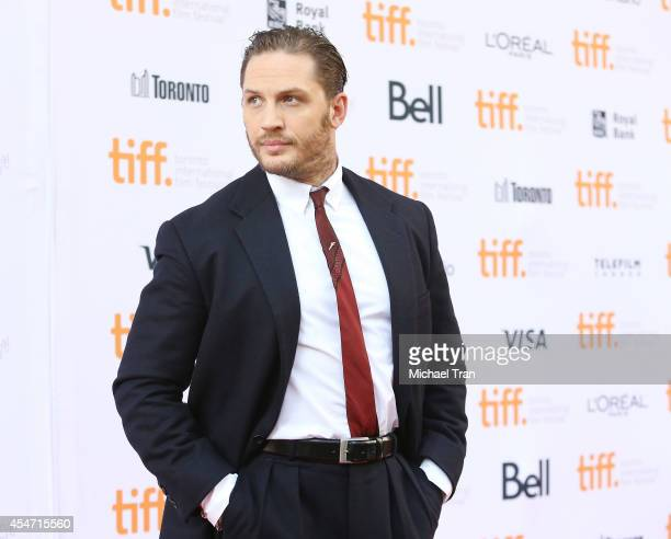 Tom Hardy arrives at the premiere of The Drop held during the 2014 Toronto International Film Festival Day 2 on September 5 2014 in Toronto Canada