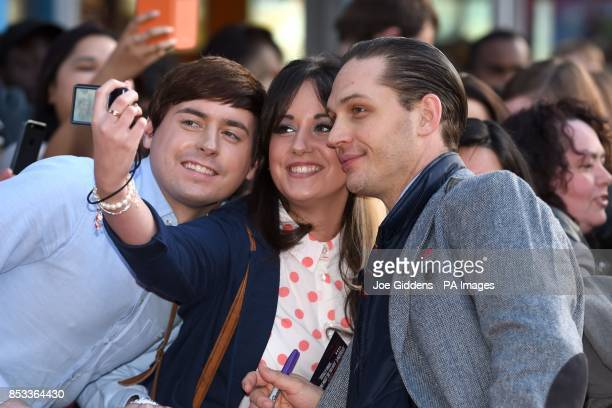 Tom Hardy poses for photos with fans before the premiere of his film Locke at Cineworld Broad Street Birmingham