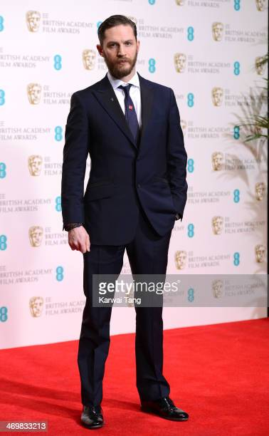 Tom Hardy poses in the winners room at the EE British Academy Film Awards 2014 at The Royal Opera House on February 16 2014 in London England