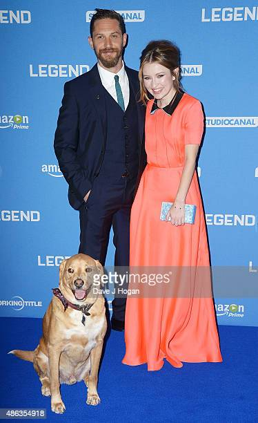 Tom Hardy with his dog Woody and Emily Browning attend the UK Premiere of 'Legend' at Odeon Leicester Square on September 3 2015 in London England