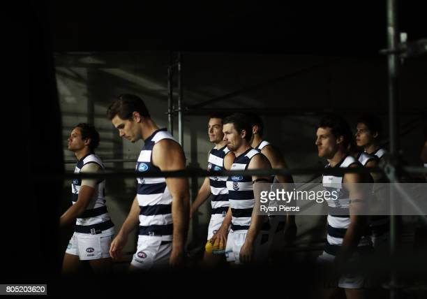 Tom Hawkins and Patrick Dangerfield of the Cats lead their team out during the round 15 AFL match between the Greater Western Sydney Giants and the...