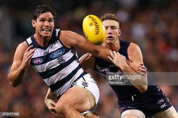 Tom Hawkins of the Cats and Zac Dawson of the Dockers contest for the ball during the round 17 AFL match between the Fremantle Dockers and the...