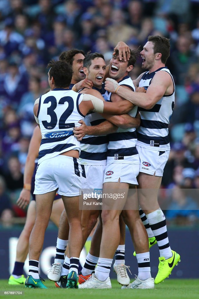 Tom Hawkins of the Cats celebrates a goal with Harry Taylor and Patrick Dangerfield of the Cats during the round one AFL match between the Fremantle Dockers and the Geelong Cats at Domain Stadium on March 26, 2017 in Perth, Australia.