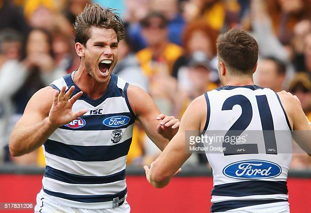 Tom Hawkins of the Cats celebrates a goal with Jordan Murdoch during the round one AFL match between the Geelong Cats and the Hawthorn Hawks at...