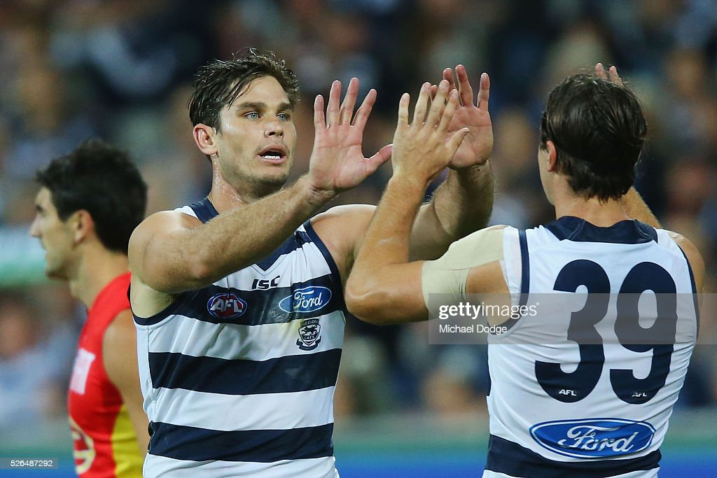 Tom Hawkins of the Cats (L) celebrates a goal with Shane Kersten during the round six AFL match between the Geelong Cats and the Gold Coast Suns at Simonds Stadium on April 30, 2016 in Geelong, Australia.