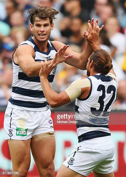 Tom Hawkins of the Cats celebrates a goal with Steven Motlop during the round one AFL match between the Geelong Cats and the Hawthorn Hawks at...