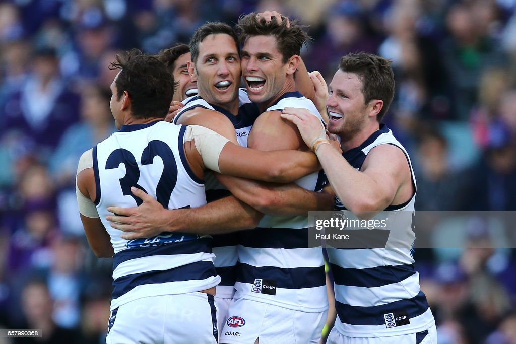 Tom Hawkins of the Cats celebrates a goal with Steven Motlop, Harry Taylor and Patrick Dangerfield of the Cats during the round one AFL match between the Fremantle Dockers and the Geelong Cats at Domain Stadium on March 26, 2017 in Perth, Australia.