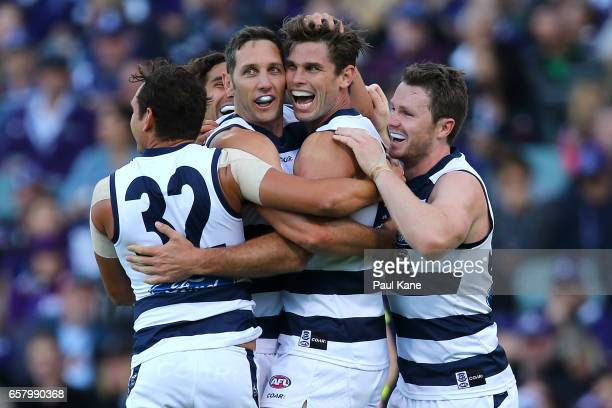Tom Hawkins of the Cats celebrates a goal with Steven Motlop Harry Taylor and Patrick Dangerfield of the Cats during the round one AFL match between...