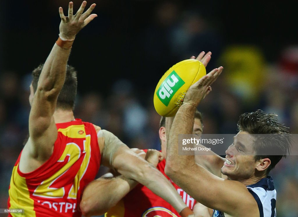 Tom Hawkins of the Cats competes for the ball against Jack Leslie of the Suns during the round six AFL match between the Geelong Cats and the Gold Coast Suns at Simonds Stadium on April 30, 2016 in Geelong, Australia.