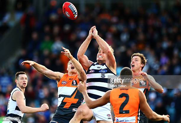 Tom Hawkins of the Cats contests a mark during the round 17 AFL match between the Greater Western Sydney Giants and the Geelong Cats at Star Track...