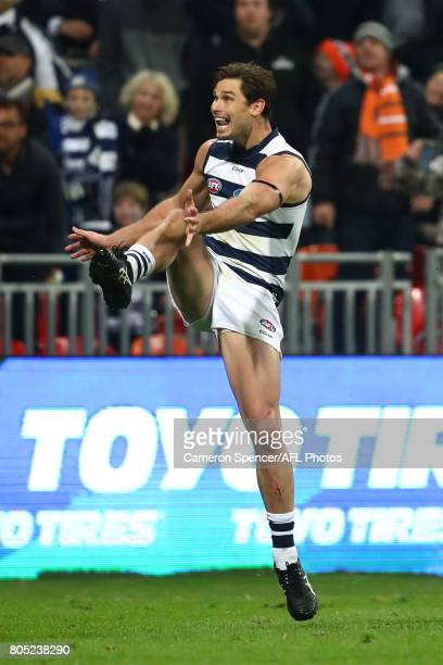 Tom Hawkins of the Cats kicks a behind on the final siren to draw the match during the round 15 AFL match between the Greater Western Sydney Giants...