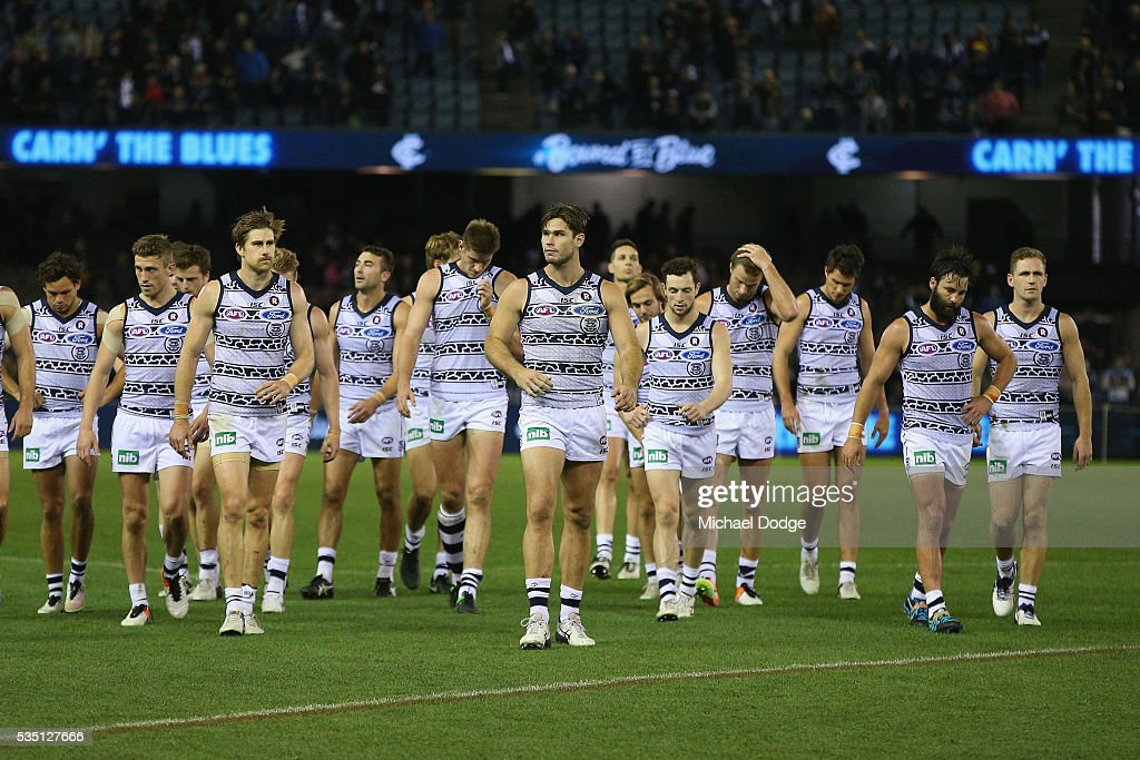 <a gi-track='captionPersonalityLinkClicked' href=/galleries/search?phrase=Tom+Hawkins+-+Australian+Rules+Football+Player&family=editorial&specificpeople=10985150 ng-click='$event.stopPropagation()'>Tom Hawkins</a> of the Cats (C) leads the team off after defeat during the round 10 AFL match between the Carlton Blues and the Geelong Cats at Etihad Stadium on May 29, 2016 in Melbourne, Australia.