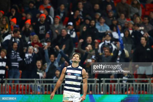 Tom Hawkins of the Cats reacts after kicking a behind on the final siren to draw the match during the round 15 AFL match between the Greater Western...