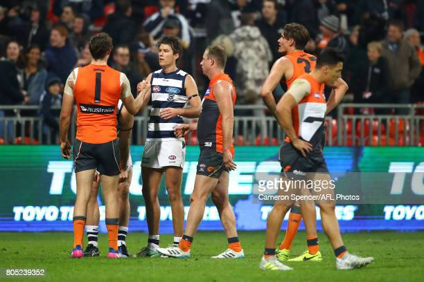 Tom Hawkins of the Cats shakes hands with Phil Davis of the Giants following the round 15 AFL match between the Greater Western Sydney Giants and the...