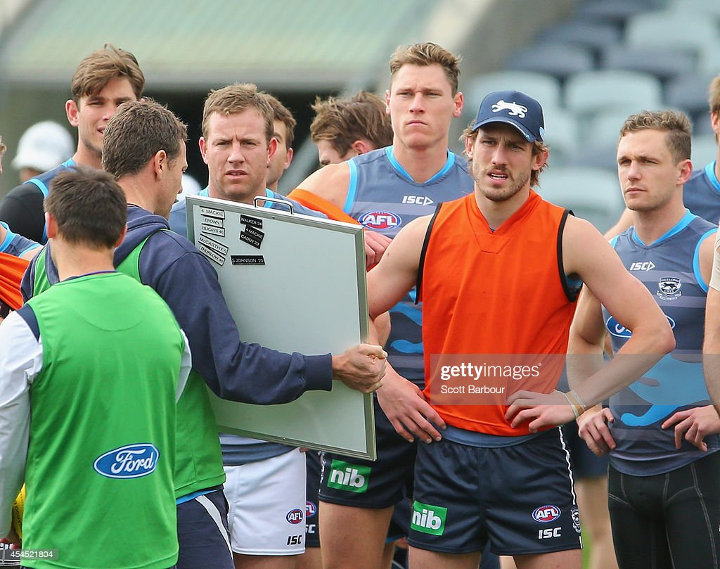 Tom Hawkins, Steve Johnson, Hamish McIntosh, Billie Smedts and Joel Selwood listen during a Geelong Cats AFL training session at Simonds Stadium on September 3, 2014 in Geelong, Australia.
